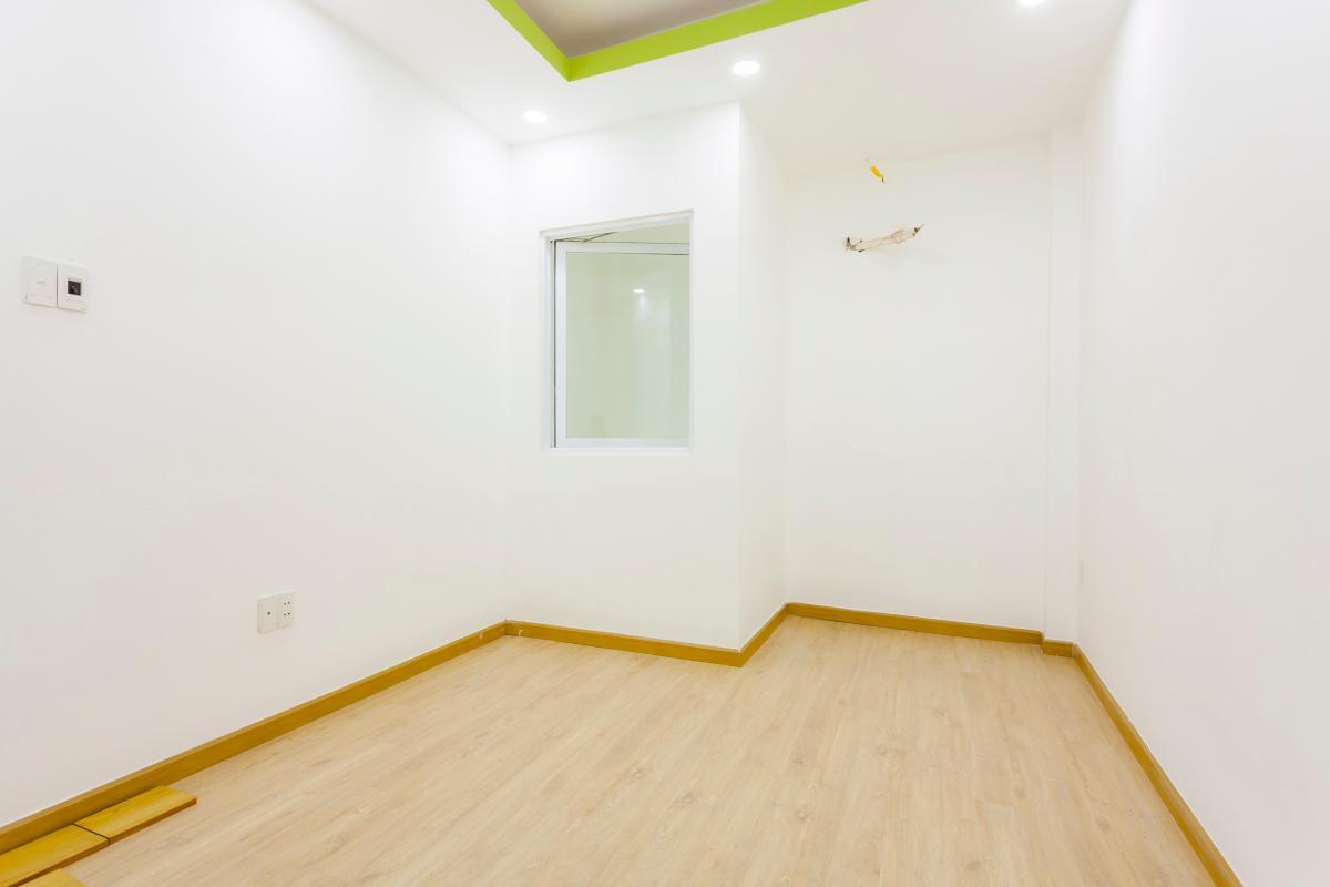 Phòng ngủ 2 tầng 1 Nhà 4 tầng hẻm Phan Xích Long hướng Đông Nam thoáng mát