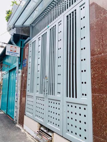 Bán nhà phố hẻm đường Huỳnh Tấn Phát, phường Phú Thuận, quận 7, diện tích đất 54m2, hướng cửa Tây Bắc.