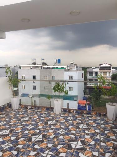 Sân thượng nhà phố đường Đào Sư Tích, Nhà Bè Nhà phố mặt tiền hướng Đông Nam diện tích 52m2, khu dân cư an ninh.