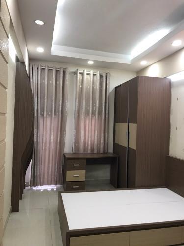 Phòng ngủ nhà phố Quận 1 Nhà phố trung tâm thành phố Quận 1 hướng Nam, đầy đủ nội thất.