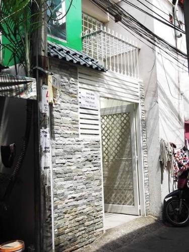 Bán nhà hẻm 3 tầng đường Tôn Đản, sổ hồng đầy đủ, dân cư sầm uất.