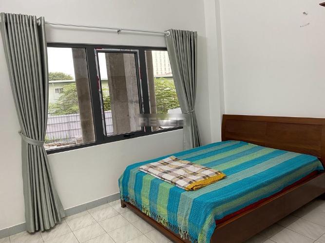 Phòng ngủ nhà phố Lê Thánh Tôn, Quận 1 Nhà phố trung tâm Quận 1 nội thất đầy đủ, nằm trong hẻm xe hơi.
