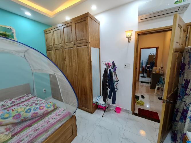 Phòng ngủ nhà phố Bình Thạnh Nhà phố Bình Thạnh diện tích đất 52.9m2, hướng Đông Bắc.