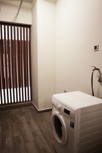 Phòng giặt Phú Mỹ Hưng Midtown Căn hộ Phú Mỹ Hưng Midtown đầy đủ nội thất, ban công thoáng mát.