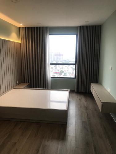 Phòng ngủ căn hộ Riviera Point Căn hộ Riviera Point phòng ngủ lót sàn gỗ, view thành phố sầm uất.