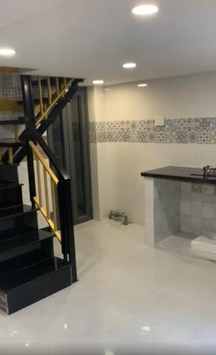 Phòng bếp nhà phố Cách Mạng Tháng 8, Quận 10 Nhà phố trung tâm quận 10, căn góc 2 mặt tiền hẻm, rộng 70m2.