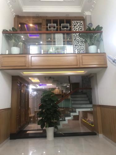 Phòng khách nhà phố Quận Gò Vấp Nhà phố diện tích đất 62.9m2, hướng Đông Nam, sổ hồng riêng