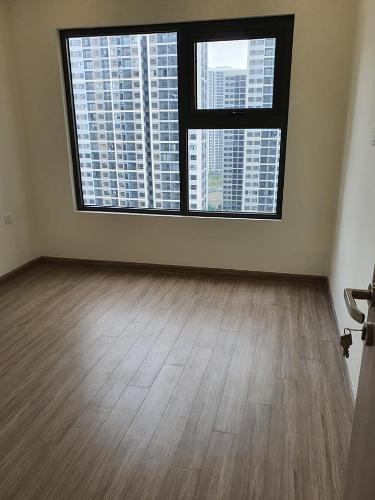 Phòng ngủ căn hộ Vinhomes Grand Park Căn hộ tầng 10 Vinhomes Grand Park view nội khu, phòng ngủ lót sàn gỗ.