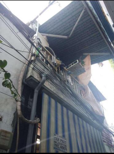 Nhà phố hướng Bắc hẻm 2m đường Tôn Đản, sổ hồng bàn giao ngay.