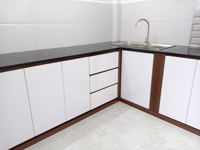 Khu vực bếp nhà phố Tôn Đản, Quận 4 Nhà phố quận 4 rộng 27.3m2, sổ hồng riêng, nội thất cơ bản.