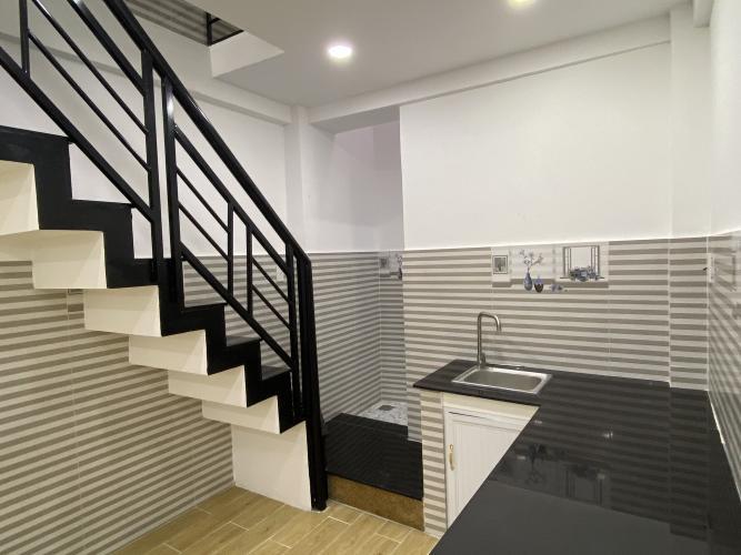 Phòng bếp nhà phố Nhà phố hẻm xe máy diện tích đất 3mx11m, hướng Bắc.