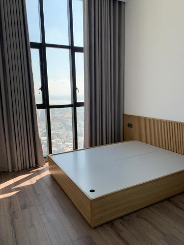 phòng ngủ penthouse riviera point Căn hộ Penthouse Riviera Point tầng cao, ngắm nhìn thành phố.