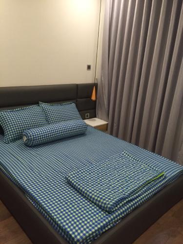 Phòng ngủ Vinhomes Central Park Căn hộ Vinhomes Central Park hướng Đông Nam, nội thất đầy đủ.