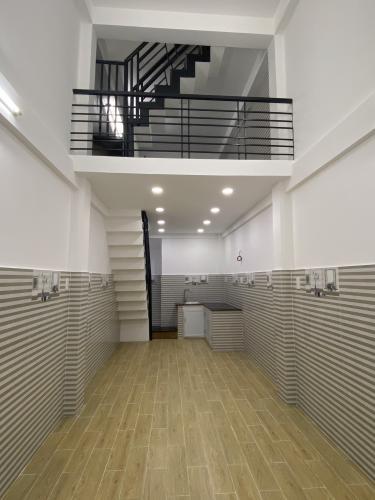 Phòng khách nhà phố Nhà phố hẻm xe máy diện tích đất 3mx11m, hướng Bắc.