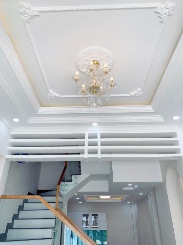 Phòng khách nhà phố Quận Tân Phú Nhà phố Q.Tân Phú hướng Tây diện tích sử dụng 172.8m2, đầy đủ nội thất.