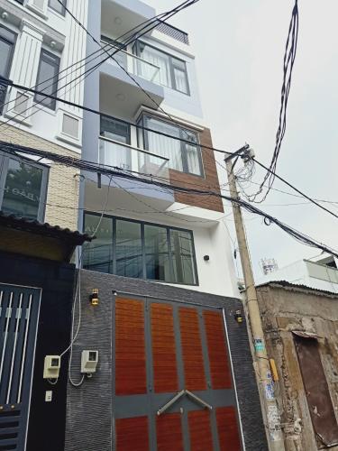 Nhà phố hẻm xe hơi Quận Tân Bình hướng Tây Nam, sổ hồng riêng.