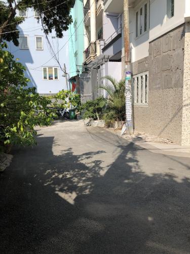 Đường trước nhà phố Quận Gò Vấp Nhà phố hẻm xe hơi đường Phạm Văn Chiêu, kết cấu 1 trệt 2 lầu kiên cố.
