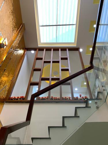 Cầu thang nhà phố Nhà phố Bình Thạnh diện tích đất 59m2, hẻm trước nhà 6m.