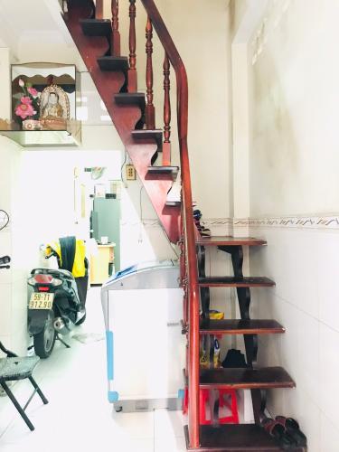 Phòng khách nhà phố Quận 1  Nhà phố đường hẻm  Trần Quang Khải, sổ hồng đầy đủ, diện tích đất 28.6m2.