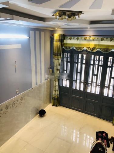 Phòng khách nhà phố Trương Đình Hội, Quận 8 Nhà phố diện tích 38.5m2, thiết kế kỹ lưỡng cùng gam màu xanh mát.