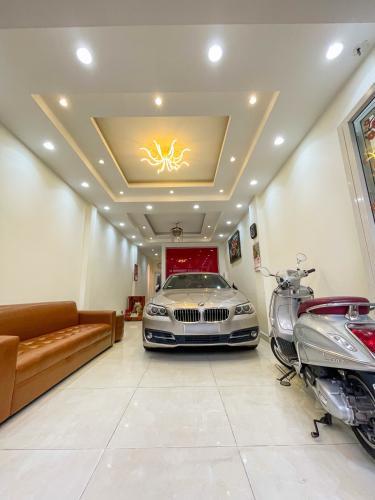 Phòng khách nhà phố Quận Phú Nhuận Nhà phố Quận Phú Nhuận hướng Đông thoáng mát, nội thất cơ bản.