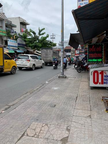 Đường trước mặt bằng kinh doanh Quận Tân Phú Mặt bằng kinh doanh kết cấu 1 trệt, 1 lầu, khu vực kinh doanh sầm uất.